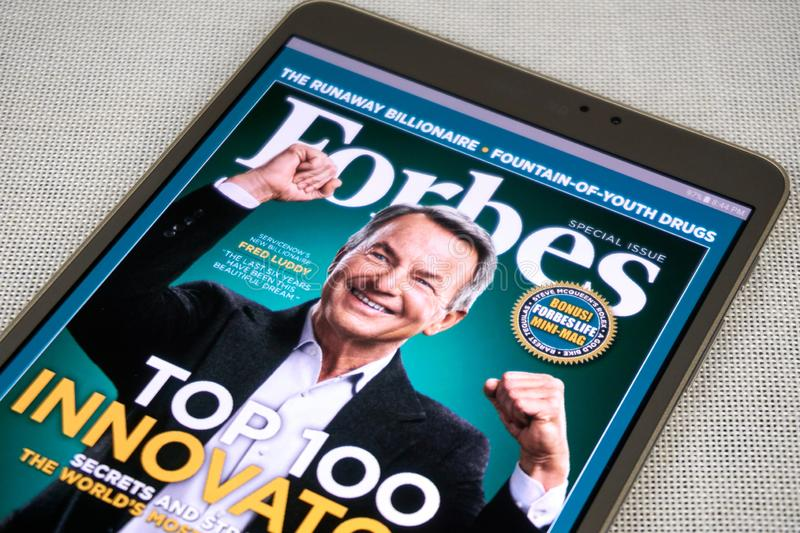 Forbes magazine on a Samsung Galaxy tablet screen. MONTREAL, CANADA - SEPTEMBER 8, 2018: Forbes magazine on a Samsung Galaxy tablet in hands royalty free stock image
