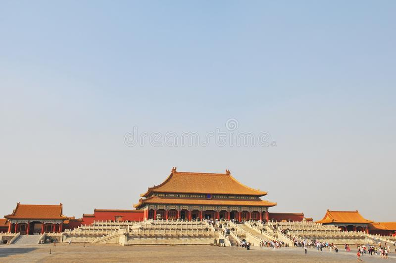 Forbidden City Sunset, Beijing, China. Cityscape of the Forbidden City with tourists walking towards the Hall of Supreme Harmony, Beijing, China royalty free stock photo