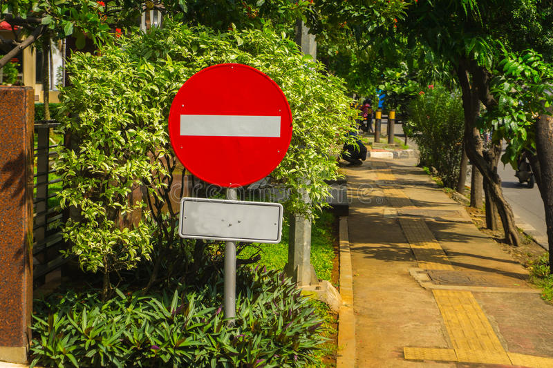 Forbidden sign board with red colour and horizontal white line in the middle photo taken in Jakarta Indonesia stock photos