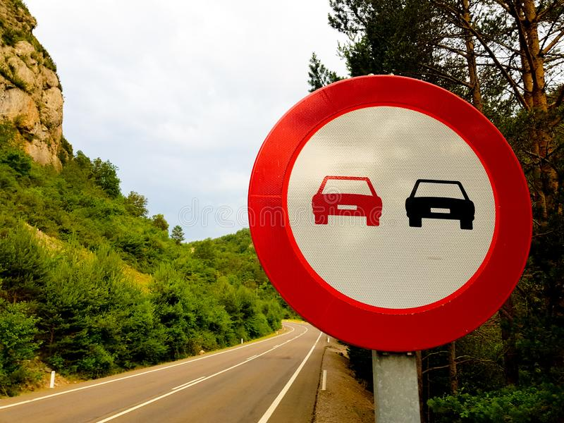Forbidden signal overtaking on a road without vehicles.  stock image