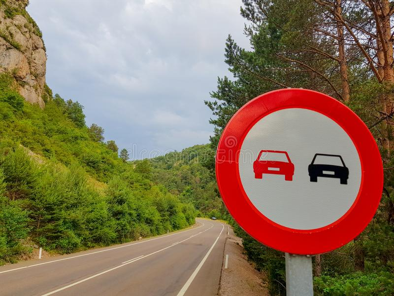 Forbidden signal overtaking on a road without vehicles.  royalty free stock photos