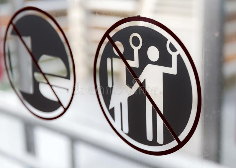Forbidden to harass women sign Jakarta. Forbidden to harass, violate or sexual intimidate women sign on the public transportation bus in Jakarta, Indonesia royalty free stock photo