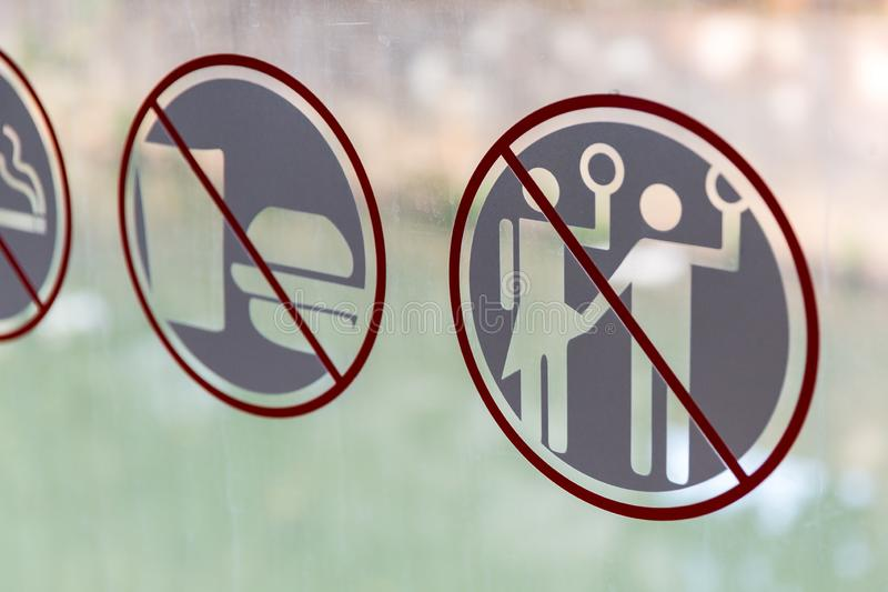 Forbidden to sexually intimidate women in the bus in Jakarta. Forbidden to harass, violate or sexual intimidate women sign on the public transportation bus in royalty free stock image