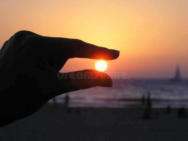 Force Perspective Photo Of Person Holding Sun Free Public Domain Cc0 Image