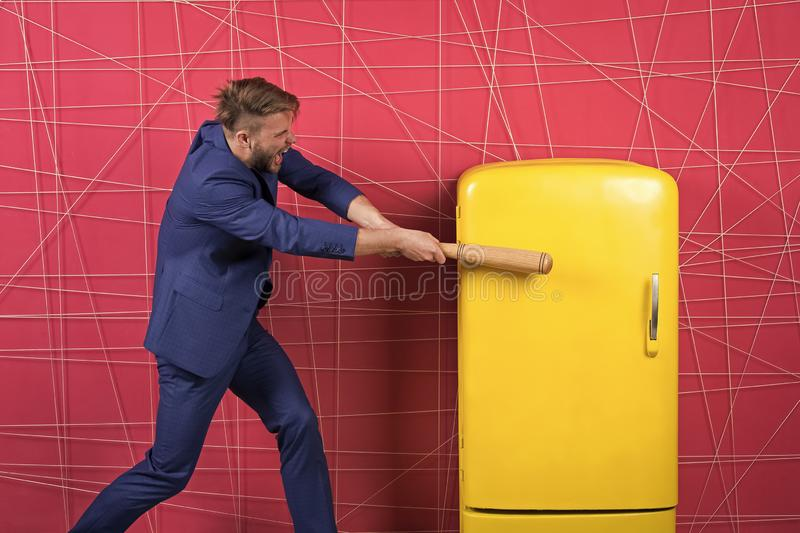 By force or persuasion. sexy man in stylish jacket. confident businessman in suit. Businessman with bat hit yellow. Fridge. angry man. Feel the success stock images