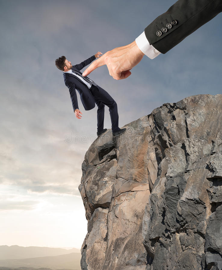 Forced dismissal for problem with boss. Boss launches his employee from the peak of the mountain stock image