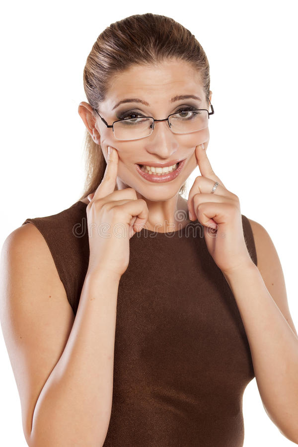 Forced smile stock photo