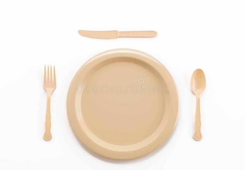 forcella e coltello di plastica del cucchiaio del piatto immagini stock libere da diritti