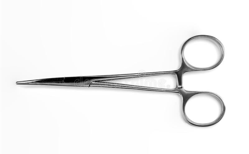Forceps chirurgical sur le fond blanc, vue supérieure photo libre de droits