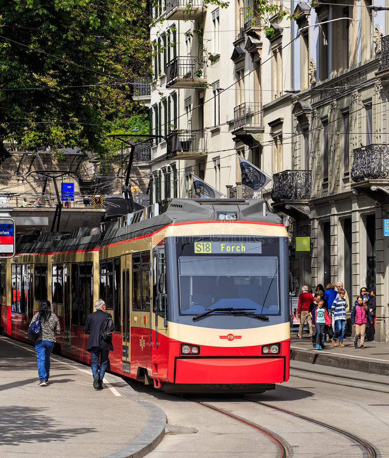Forch railway train in Zurich. Zurich, Switzerland - 25 May, 2016: a Forch railway train at the stop at Stadelhoferplatz square. The Forch railway German royalty free stock photography