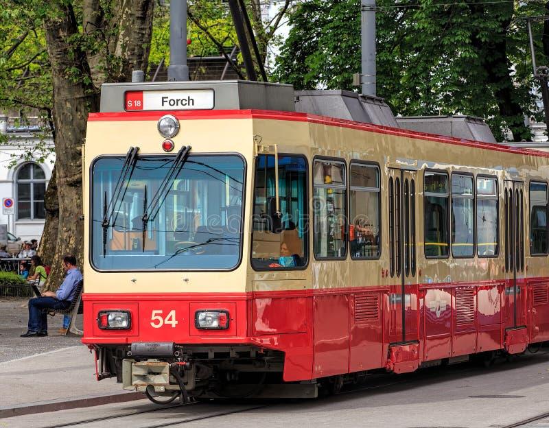 Forch railway train in Zurich. Zurich, Switzerland - 25 May, 2016: a Forch railway train at the stop at Stadelhoferplatz square. The Forch railway German stock image