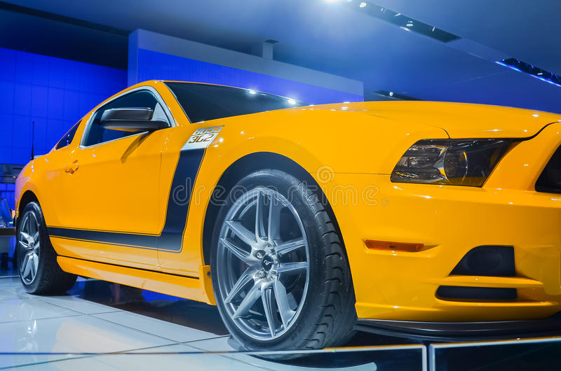 2012 Ford Boss 302 Mustang. DETROIT, MI/USA - JANUARY 15, 2012: A School Bus Yellow Ford Boss 302 Mustang car on display at the North American International Auto royalty free stock images