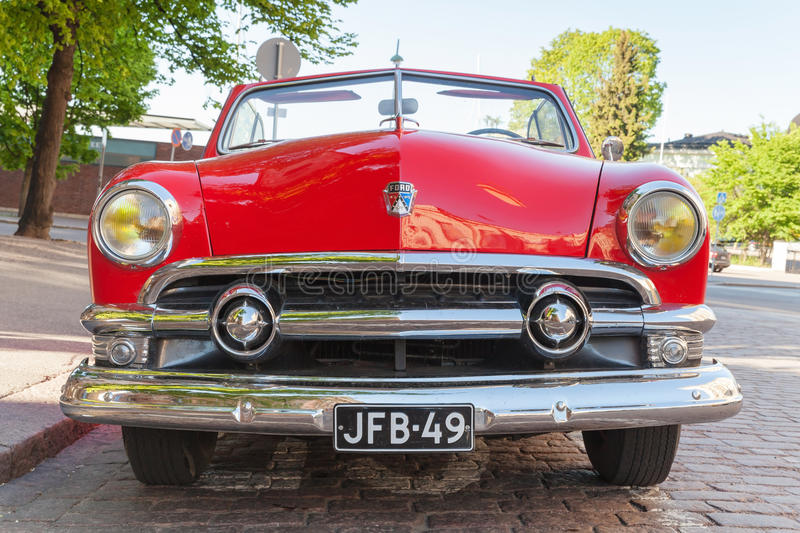 Ford Custom Deluxe Tudor 1951 car, front view. Helsinki, Finland - June 13, 2015: Old red Ford Custom Deluxe Tudor car is parked on the roadside. 1951 year royalty free stock photography