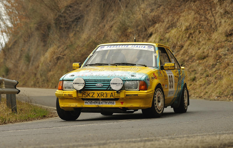 Ford Escors xr3i rally. A Ford Escort xr3i on race during the 1th edition of Vallate Aretine historical rally; 19th march 2011 stock photos