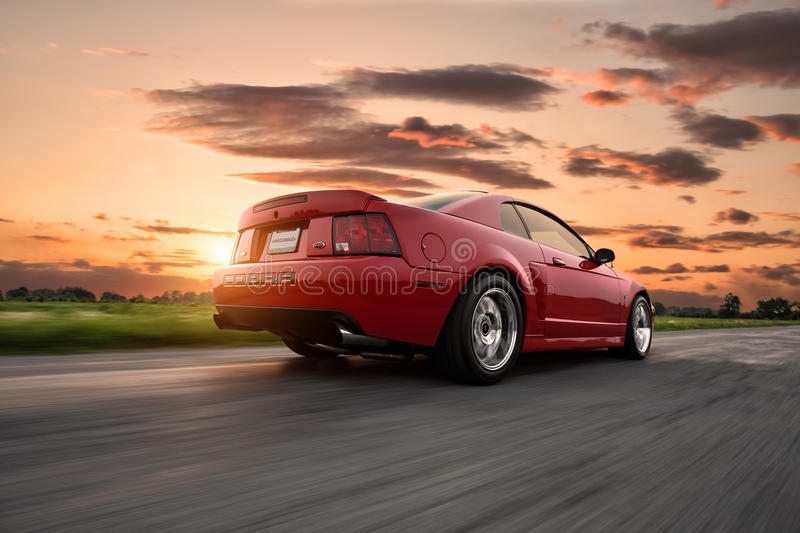 Ford Mustang Cobra. A Ford Mustang Cobra cruising down the road stock images