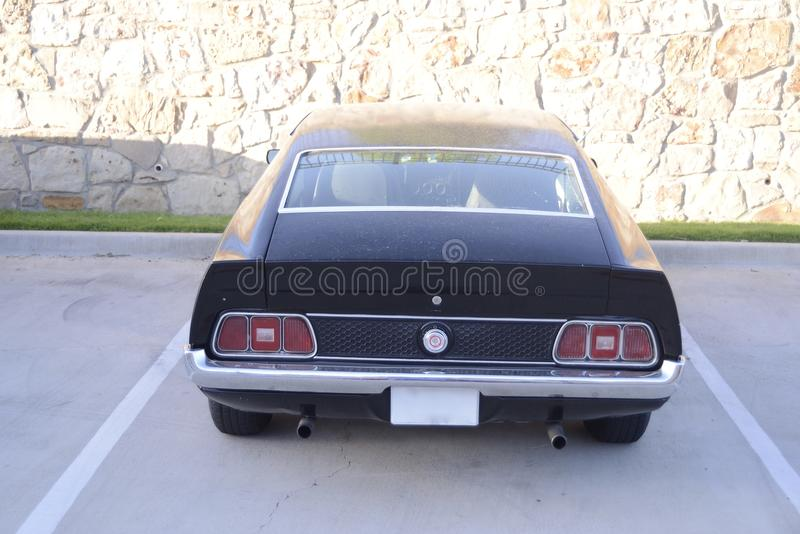 Ford Mustang Mach I Taillights. The Ford Mustang Mach 1 is a performance-oriented option package of the Ford Mustang, originally introduced by Ford in August stock image