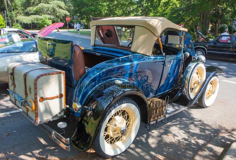 1930 Ford Roadster Automobile. MATTHEWS, NC USA - May, 12, 2018: A 1930 Ford Roadster on display at the Cruisin` Car Show, part of the Matthews Beach Fest royalty free stock photography