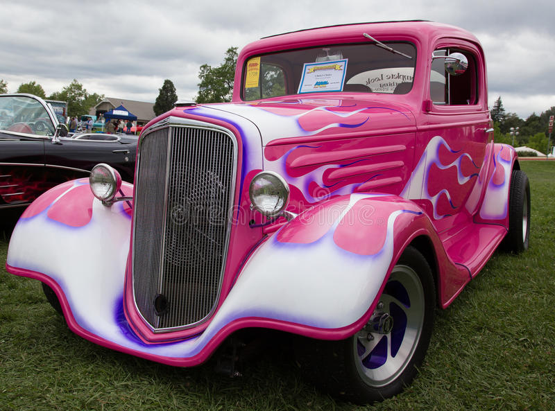 Ford Window Coupe from 1933. Redding, California, USA- April 27, 2014: A 1933 pink and purple flamed Ford Window Coupe is on display at the Kool April Nights stock photos