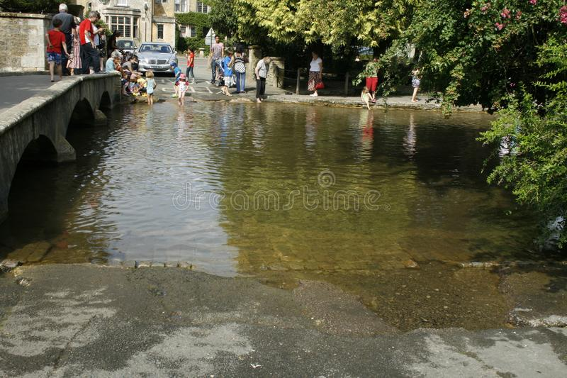 Fording the River Windrush, Bourton On The Water. Gloucestershire. UK royalty free stock photo