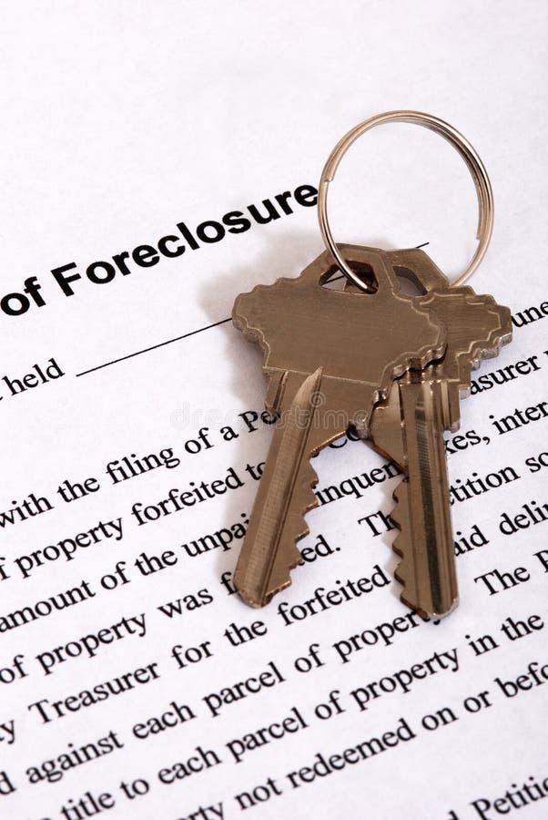 Foreclosure form & Housekeys stock photos