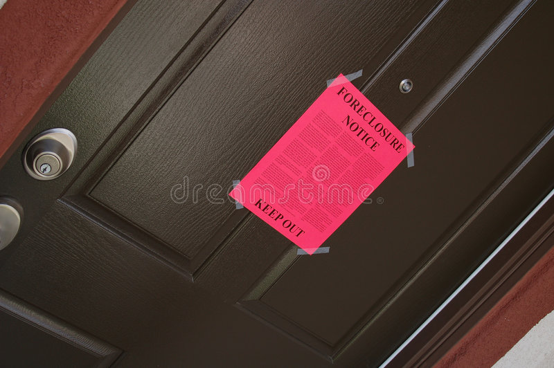 Foreclosure Notice. Forclosure Notice on Door - Housing bubble has burst royalty free stock images