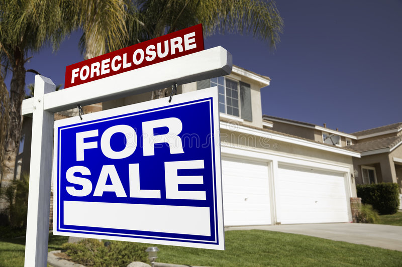 Foreclosure For Sale Real Estate Sign and House stock images