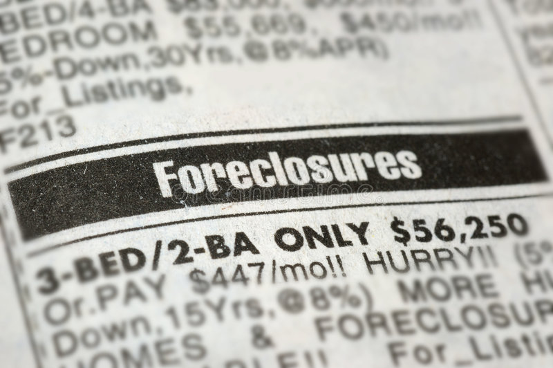 Foreclosures. With the current economic situation, many are forced to foreclose. Closeup shot of foreclosure newspaper ad royalty free stock photography