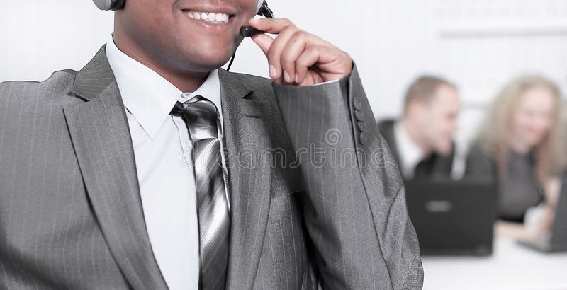 Foreground the employee call center with headset on the backgro stock photo