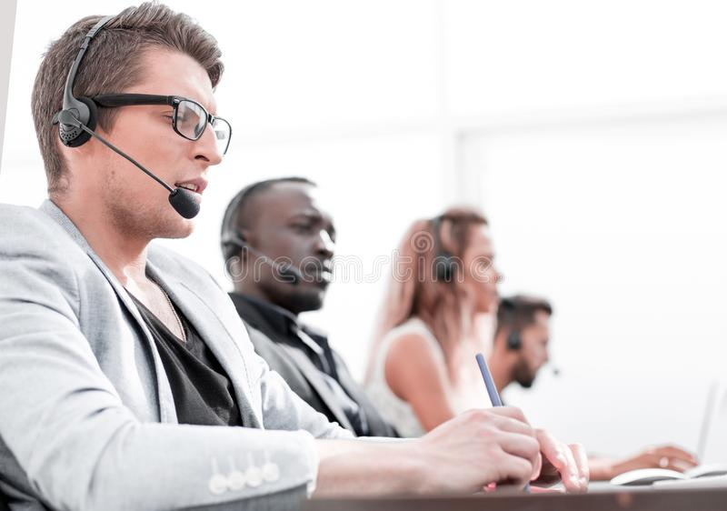 In the foreground .employee call center in the office. stock photo