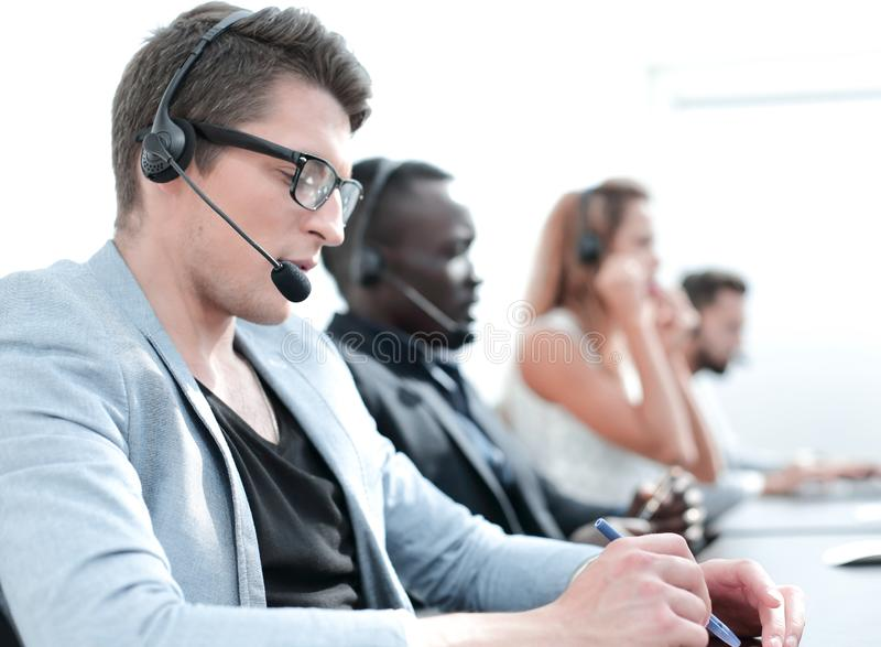 In the foreground .employee call center in the office. stock photos