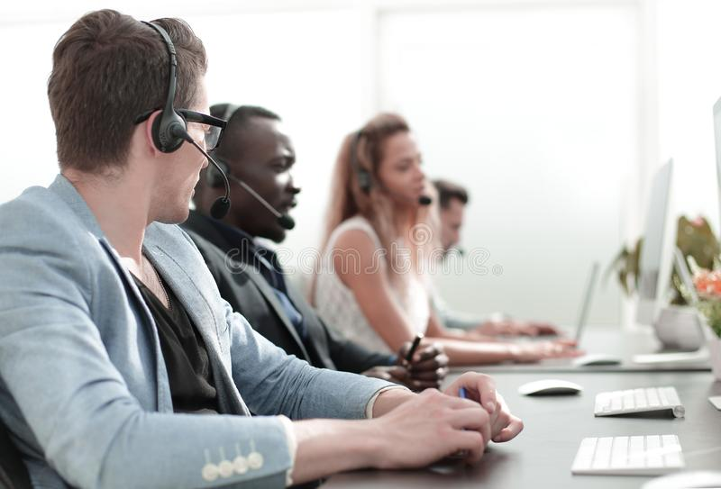 In the foreground .employee call center in the office. stock image
