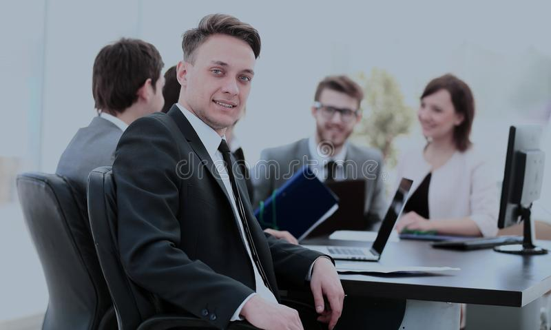 young employee in the workplace and the business team in the bac stock photography