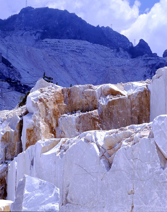 Carrara, white marble quarries on the Apuan Alps. In the foreground excavation of marble from the quarries of Carrara Fantiscritti royalty free stock image