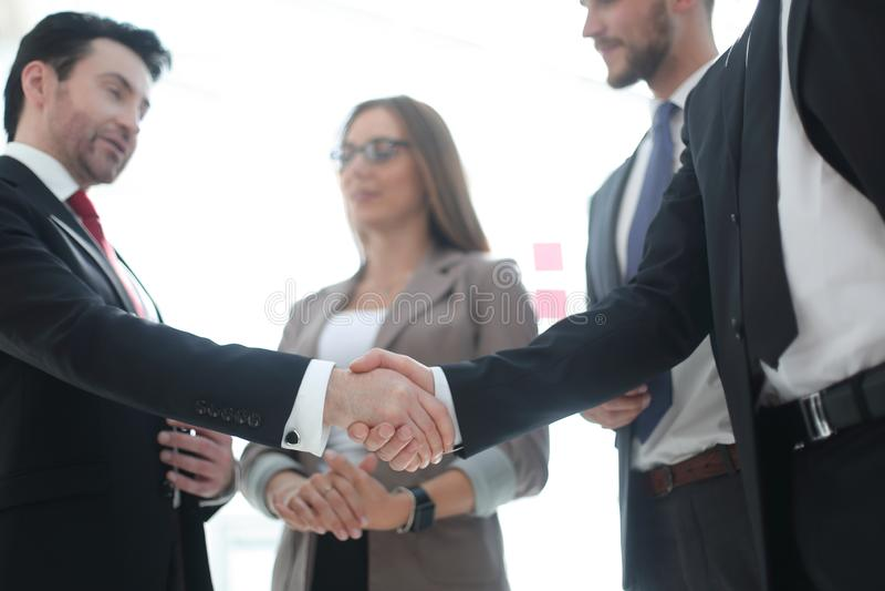 Foreground. handshake of business people stock image