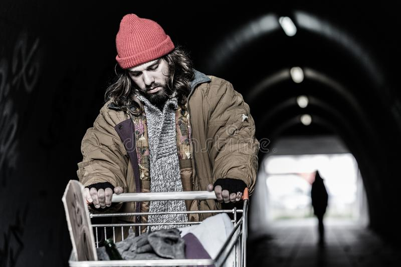 Hopeless drifter with trolley royalty free stock images