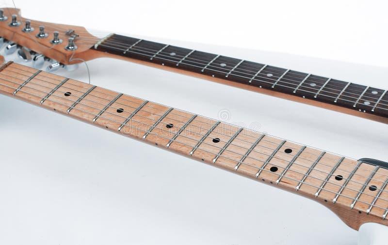 foreground o fretboard de uma guitarra ac?stica Isolado no branco imagens de stock royalty free