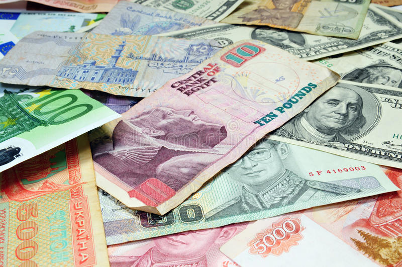 Foreigh curreny. Pile of foreign currency for background royalty free stock images