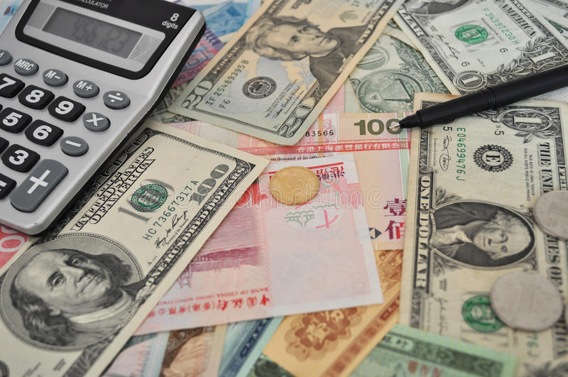 Foreign currencies. With catulator closeup stock image