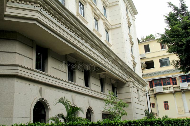 Shamian Guangzhou city historical building. Foreign institution, historical building overseas` style, European style, brics and pillars, old trees. History of royalty free stock photography
