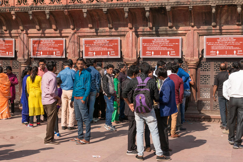Foreign and local tourist line up at ticket counters on Western Gage of Taj Mahal. AGRA, INDIA - Nov 27, 2016: Foreign and local tourist line up at ticket stock photography