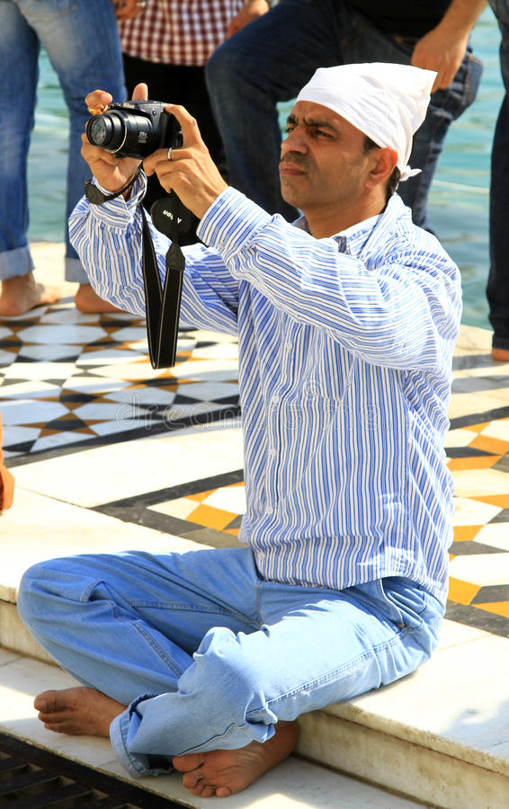 Foreign tourist. Taking photographs at holy place in india stock image