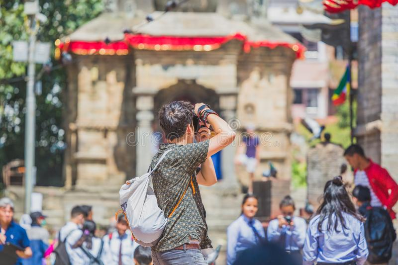 Foreign Tourist Photographer Taking Pictures in Kathmandu,Taking photos. Kathmandu,Nepal - Sep 24,2018:Foreign Tourist photographer taking photos in Kathmandu royalty free stock photos