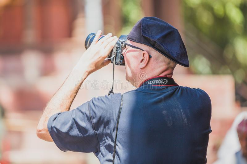 Foreign Tourist Photographer Taking Pictures in Kathmandu,Taking photos. Kathmandu,Nepal - Sep 24,2018:Foreign Tourist photographer taking photos in Kathmandu royalty free stock image