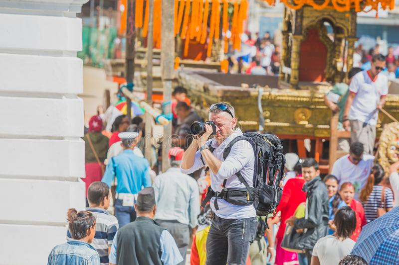 Foreign Tourist Photographer Taking Pictures in Kathmandu,Taking photos. Kathmandu,Nepal - Sep 24,2018:Foreign Tourist photographer taking photos in Kathmandu royalty free stock photo