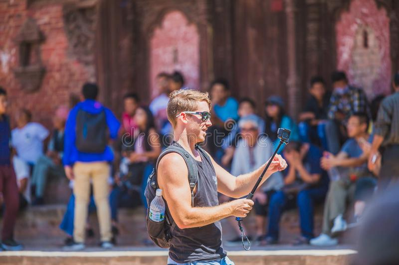 Foreign Tourist Photographer Taking Pictures in Kathmandu,Taking photos. Kathmandu,Nepal - Sep 24,2018:Foreign Tourist photographer taking photos in Kathmandu royalty free stock images