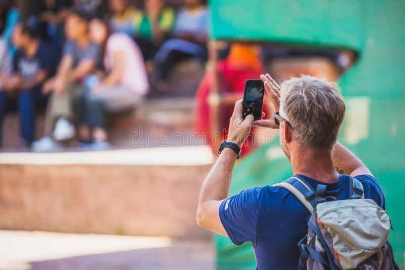 Foreign Tourist Photographer Taking Pictures in Kathmandu,Taking. Kathmandu,Nepal - Sep 24,2018:Foreign Tourist photographer taking photos in Kathmandu Nepal royalty free stock photography