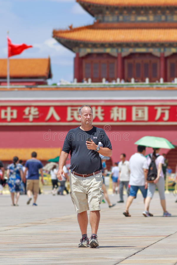 Foreign tourist on a sunny Tiananmen Square, Beijing, China. BEIJING-JUNE 11, 2016. Foreign tourist on sunny Tiananmen Square, one of the most visited sites in stock image