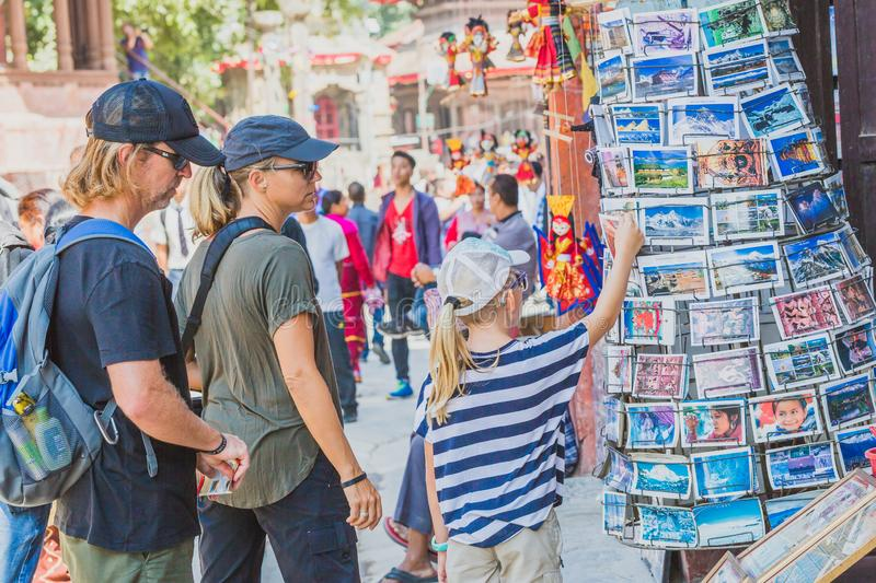 Foreign Tourists,Travellers Looking for Souvenirs at Tourist Shop in Kathmandu Durbar Square. Kathmandu,Nepal - Sep 24,2018:Foreign Tourists,Travellers Looking stock images