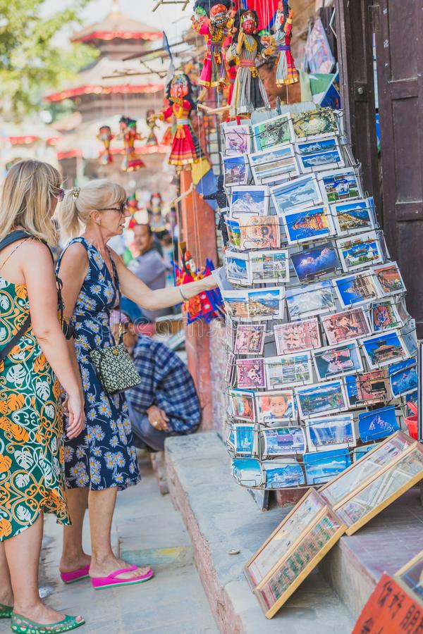 Foreign Tourists,Travellers Looking for Souvenirs at Tourist Shop in Kathmandu Durbar Square. Kathmandu,Nepal - Sep 24,2018:Foreign Tourists,Travellers Looking stock photography