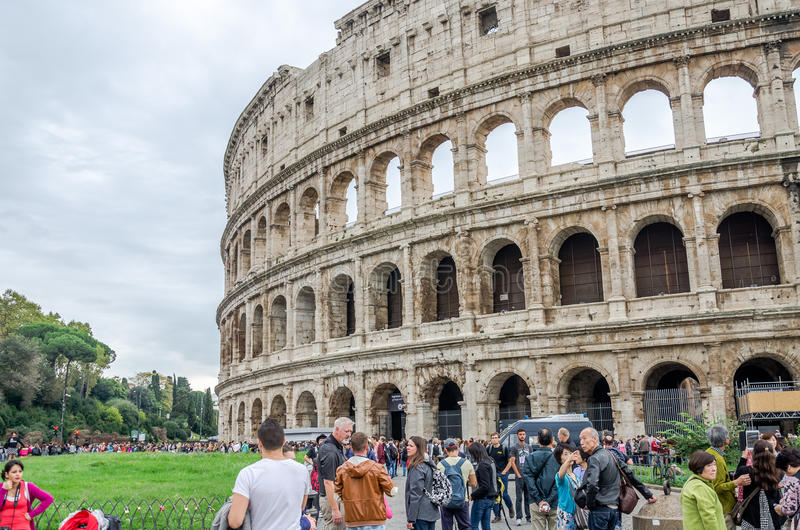 Foreign tourists on trips walk photographed and consider the main historical sites in the Italian capital Rome, the ruins of the C stock photos